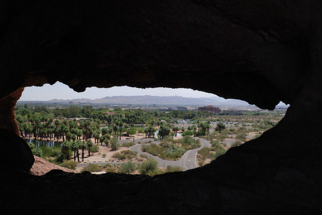 """Hole in the Rock"" at Papago Park in Phoenix Arizona. Hole In The Wall Hole In The Rock Papago Park Phoenix, AZ Arizona Phoenix Desert Oasis Frame Rock Rock Formation Rock Window Light At The End Of The Tunnel Palm Trees Pond Water Great View Elevated View High Angle View"
