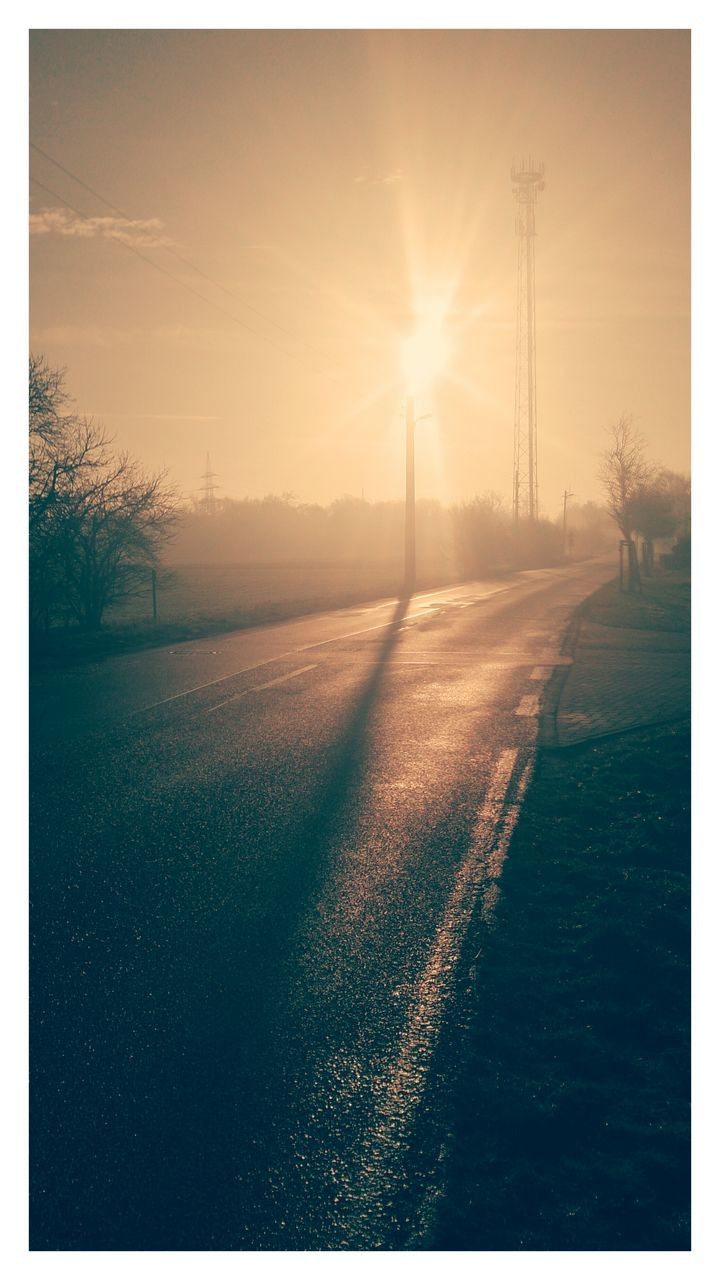 tree, sunbeam, sun, nature, field, sunlight, tranquil scene, tranquility, sunset, beauty in nature, no people, outdoors, landscape, cold temperature, scenics, bare tree, winter, road, sky, day, electricity pylon, grass
