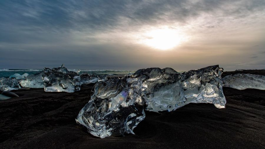 Diamonds Diamond Beach Iceland Sky Cloud - Sky Beach Land Nature Sea Water Sunset Sunlight Tranquility Rock Scenics - Nature Sun Sand Rock - Object No People Beauty In Nature Solid Ice Outdoors