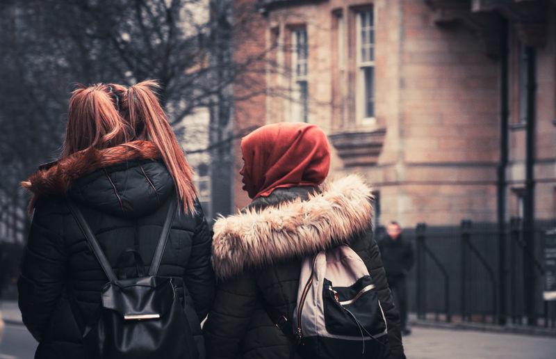 Rear view of women standing in winter