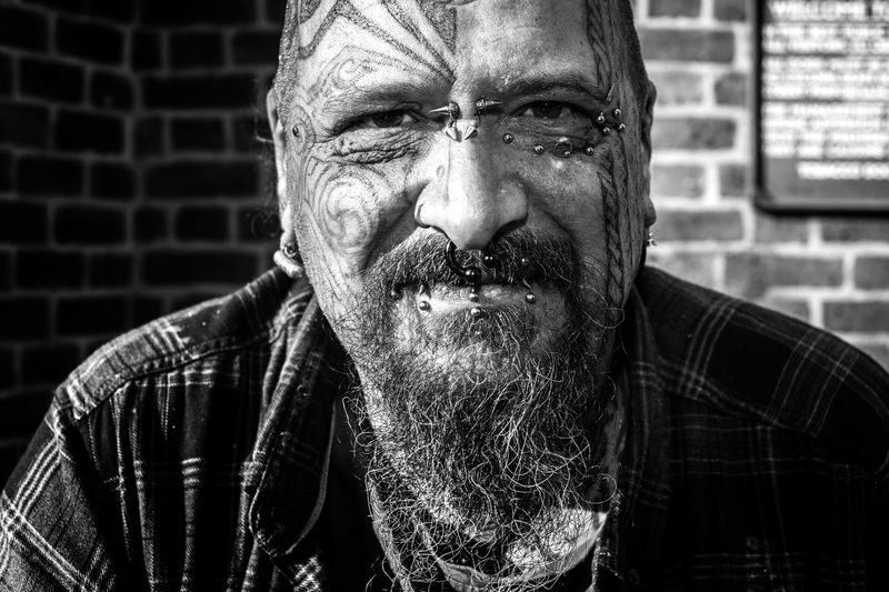 It is his life. One Person Only Men Adult One Man Only Men Outdoors Portrait Close-up Black And White Streetphotography_bw London Tattoo Convention Tattoo Streetphotography London Lifestyle Prime Lens City Stranger Maxgor Street Street Photography Cıty Rawstreets London Maxgor.com Monochrome Photography Uniqueness Art Is Everywhere The Portraitist - 2017 EyeEm Awards