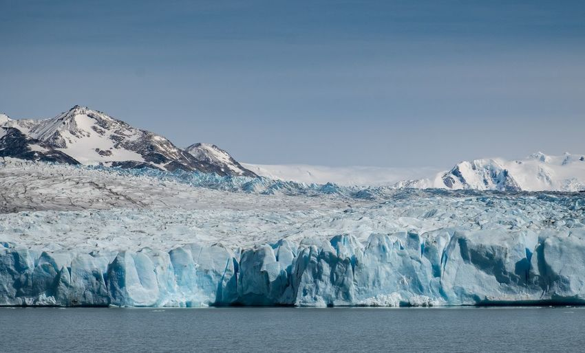 Scenic view of  a glacier against sky