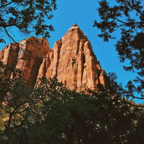 Low Angle View Of Rock Formation Against Clear Blue Sky At Zion National Park