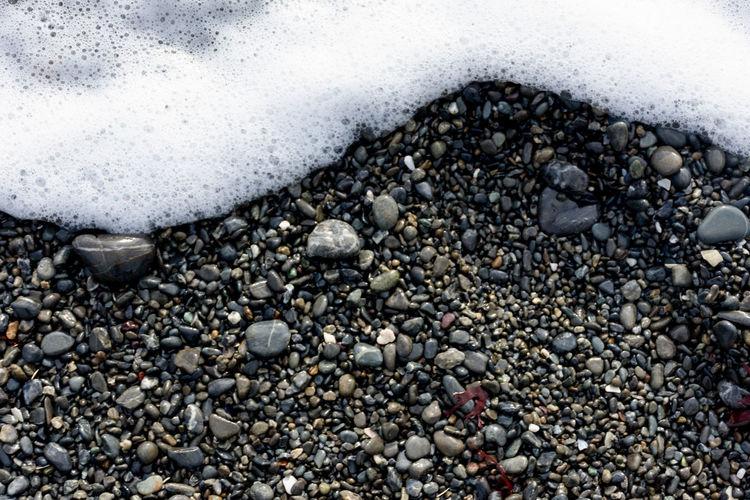 Full frame shot of pebbles on beach