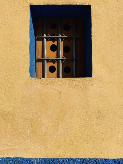 Low angle view of window on wall