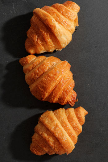 High angle view of fresh bread on table against black background