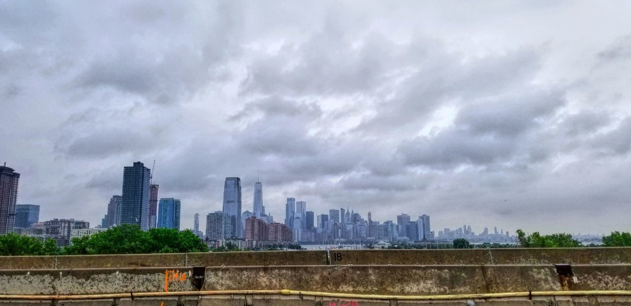 built structure, architecture, cloud - sky, sky, building exterior, city, building, urban skyline, no people, landscape, nature, office building exterior, cityscape, day, skyscraper, overcast, office, tall - high, tower, outdoors, financial district, ominous