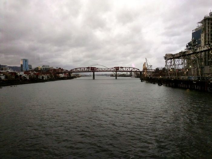 Bridges City Cityscape Urban Skyline Harbor Water Bridge - Man Made Structure Horizon Sea Business Finance And Industry Beach Overcast Calm Dramatic Sky Waterfront Idyllic Storm Cloud
