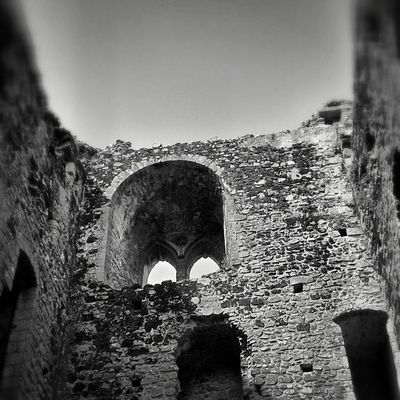 Norman Arches Bnw_zone Mediaeval keep ruins buildingstylesgf building_shotz exploring_shotz castle castlerising bnw_of_our_world archilovers arts architecture architectureporn architexture archidaily bnw_universe lookup norfolk blacandwhite monastic BlackAndWhitePhotography history heritage scenic blacknwhite_perfection