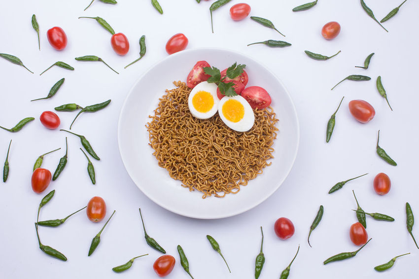 Fried noodle on a white plate styled beautifully Fried Noodles Noodles Breakfast Directly Above Egg Food Food And Drink Freshness Green Color Healthy Eating High Angle View Indoors  Meal No People Noodle Plate Ready-to-eat Still Life Studio Shot Table Temptation Wellbeing