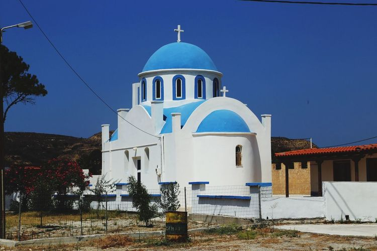 Beautiful Church Religion Place Of Worship Spirituality Architecture Dome Built Structure Blue Building Exterior Day Clear Sky Cross Outdoors White Color No People Whitewashed Travel Destinations Sky Kos Greece IAmGSPhotography