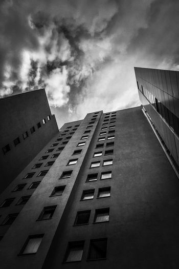 B & W Photography Black & White Photography Black And White Photography Urban Scene Urbanity Urban Architecture Vertical Shot Berlin Dramatic Sky Ominous Beauty Architecture Sky Building Exterior Cloud - Sky Built Structure Low Angle View Day Building No People City Tall - High Window Diminishing Perspective In A Row