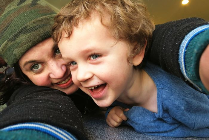 Togetherness Bonding Happiness Two People Childhood Love Mother Motherhood Mum And Son Son Familyday Floor Looking At Camera Portrait Leisure Activity Family Child Smiling Lifestyles People Real People Close-up Females Cheerful Indoors  Uniqueness