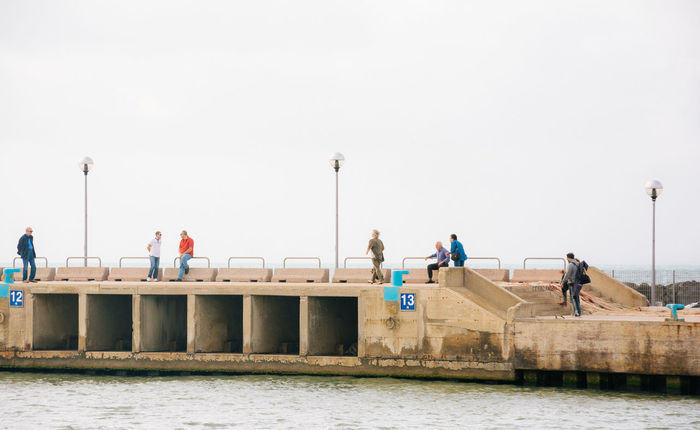 Platform 13 Built Structure Day Leisure Activity Lifestyles Medium Group Of People Men Nature Nikonphotography Outdoors Sailing Showcase June Sky Travel Destinations Vacations Vscofilm Water Waterfront