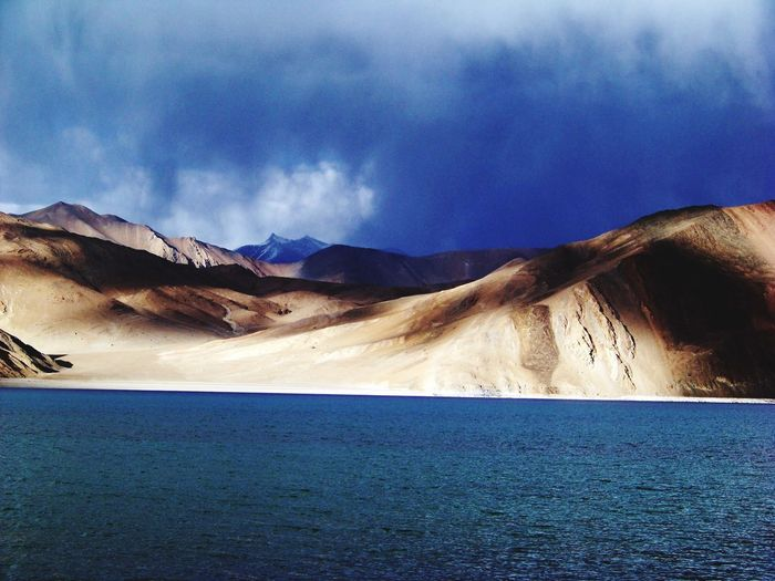 Pangong Lake! The base of mountain range Sahyadri Mountains Mountain Range Pangong Lake Scenics Mountain Tranquil Scene Beauty In Nature Nature Mountain Range EyeEmNewHere Tranquility Sky Physical Geography Landscape Cloud - Sky Blue Water
