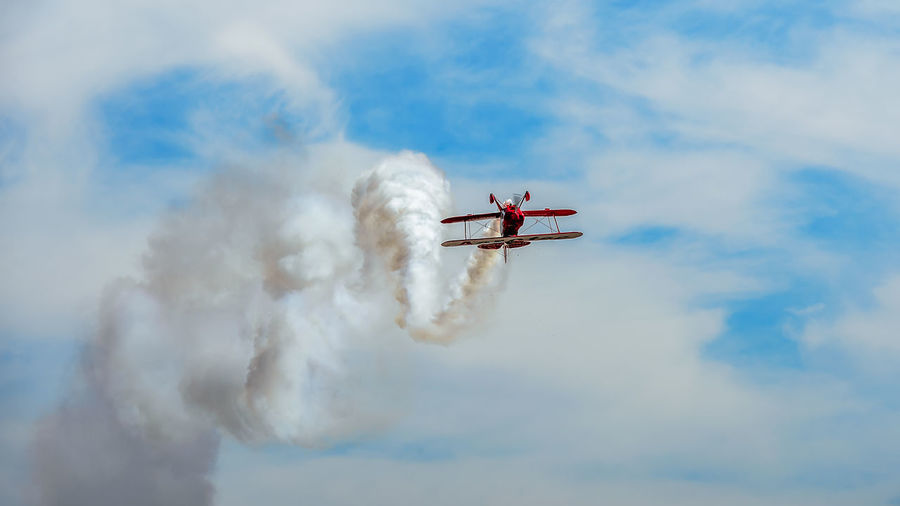 Aerobatics Aerospace Industry Air Vehicle Airplane Airshow Cloud - Sky Cooperation Day Fighter Plane Flying Low Angle View Mid-air Mode Of Transportation Motion Nature No People on the move Outdoors Plane Sky Smoke - Physical Structure Teamwork Transportation Vapor Trail