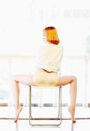 The Golden Girl Only Women Redhead One Person One Woman Only Adults Only Full Length Adult Side View One Young Woman Only People Young Adult Beautiful Woman Indoors  Sitting Day Human Body Part Young Women Abdomen Ballet Dancer Glamour Women Beautiful People Dancer Close-up Bedroom