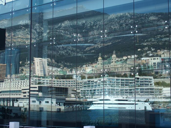 Reflection of cityscape on mountain