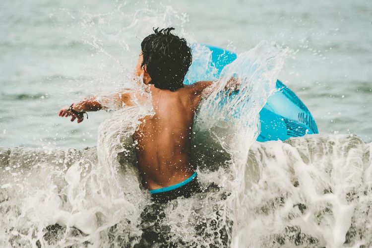Breaking the Wave Splashing Motion Leisure Activity Wave Outdoors Let's Go. Together. Childhood Simple Moment Sports Photography Beach Portoseguro Bahia Brazil Coroa Vermelha Sommergefühle EyeEm Selects Nikonphotography Connected By Travel