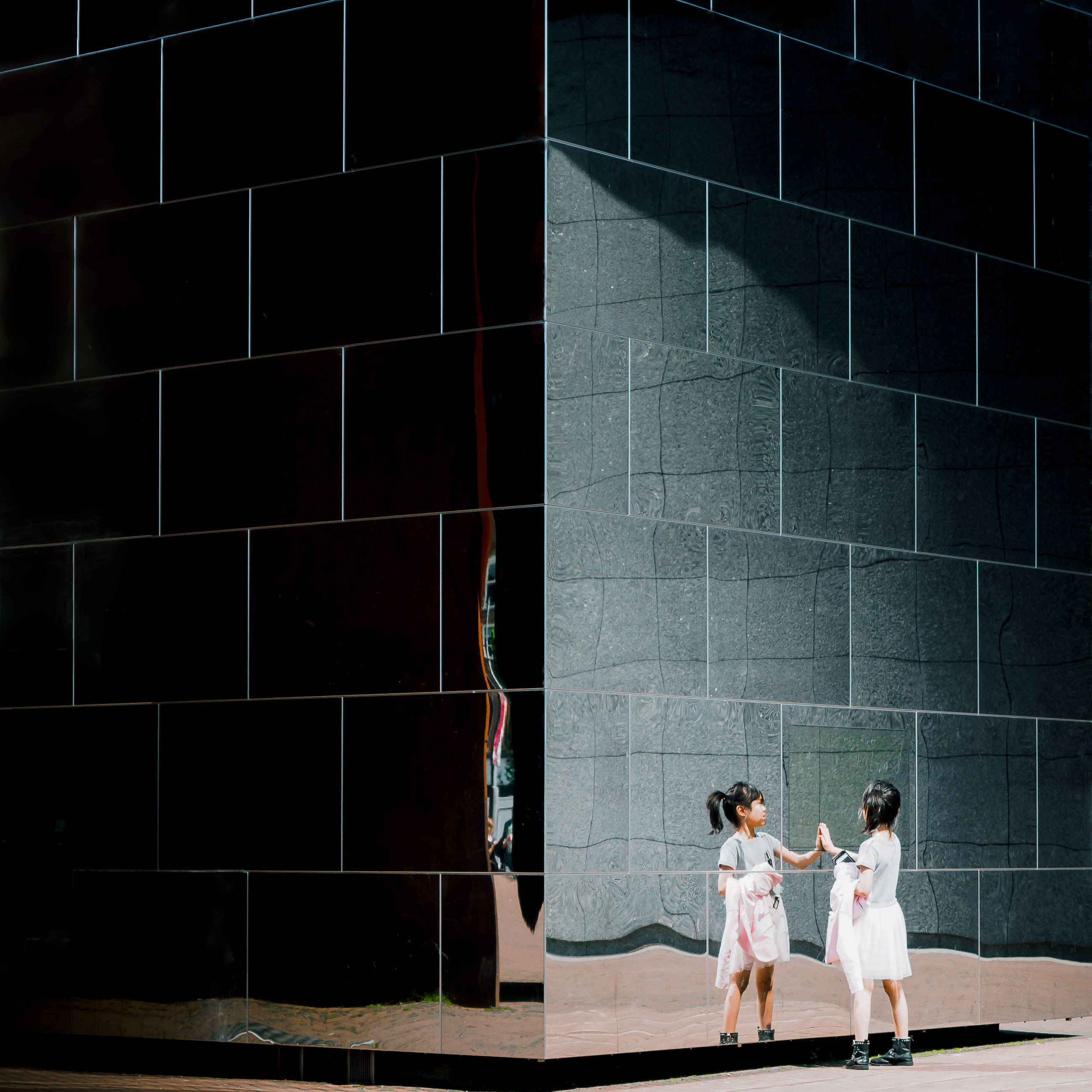 two people, architecture, women, built structure, adult, togetherness, men, wall - building feature, lifestyles, building exterior, couple - relationship, standing, young women, young adult, people, real people, females, casual clothing, day, love