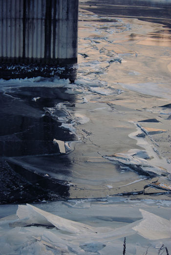 Evening Light Cold Temperature Concrete Pile Cracked Ice Day Frozen River Landscape Natural Vs Artificial Nature No People Outdoors Snow Water Winter