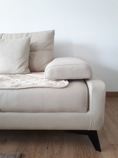 Empty chair against white wall at home