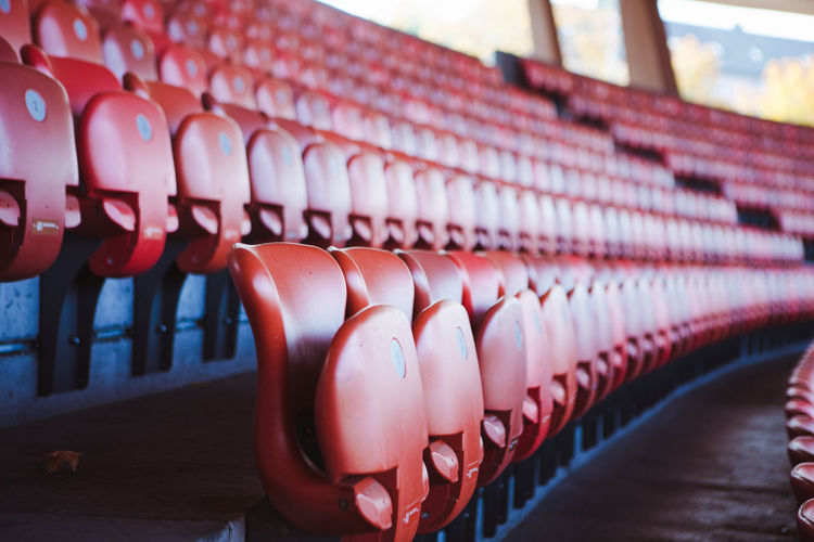Rows Of Red Seats In Sports Stadium
