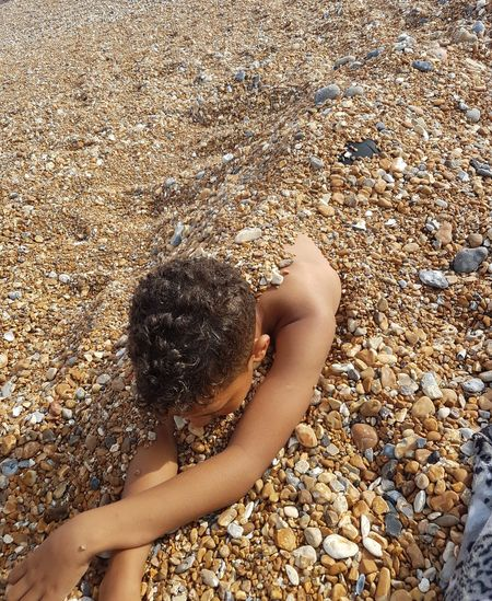 swallowed by the pebbles Low Section Water Beach Sand Human Leg Summer Women Relaxation Sunlight barefoot Shore Pebble Driftwood Pebble Beach Seaside Stone Wave Sandy Beach Ocean Calm