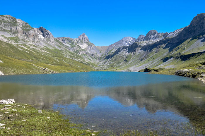 Glattalp Green Hiking Lake Landscape Majestic Mountain Mountain Range Non-urban Scene Outdoors Reflection Reflections Scenics Schwyz Summer Switzerland Tranquil Scene Water Water Reflections Landscapes With WhiteWall