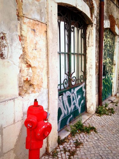 Decay Derelict Urban Decay Urban Geometry Portugal Culture Architectural Detail Urban Streetphotography Architecture Travel Photography Explore Travel Taking Photos Observing EyeEm Traveling Graffiti Fire Hydrant