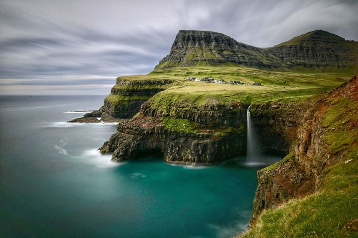 Gasadalur Longexposure The Great Outdoors - 2018 EyeEm Awards EyeEm Nature Lover Landscape Coastline Scandinavia Múlafossur Faroe Islands Gasadalur Tadaa Community Waterfall Water Scenics - Nature Mountain Sky Beauty In Nature Cloud - Sky Land Green Color Outdoors No People Sea Idyllic Nature