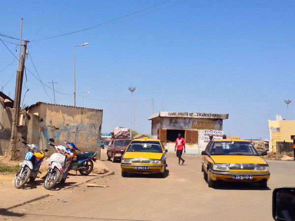 Zichuinchor Senegal West Africa Ziguinchor Africa Car Casamance City City Life Clear Sky Garage Land Vehicle Mode Of Transport Outdoors Real People Road Scooter Senegal Street Taxi Transportation Yellow Cab