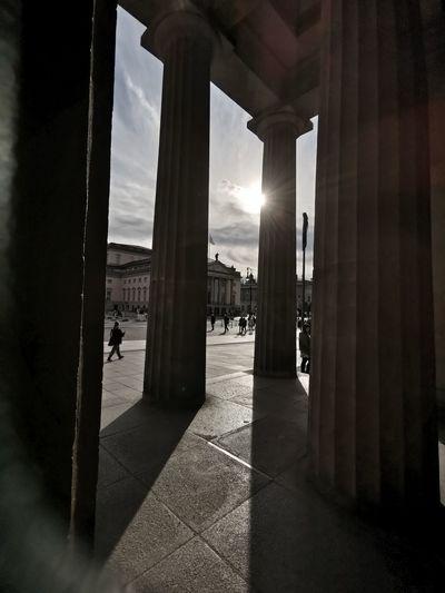 Corridor of building against sky