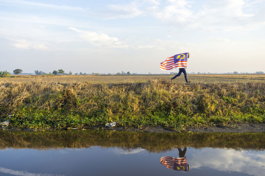 Merdeka Day Celebration Beauty In Nature Day Flag Flag Pole Grass Independence Day Lake Landscape Malaysia Nature No People Outdoors Patriotism Pride Sky Stars And Stripes Water