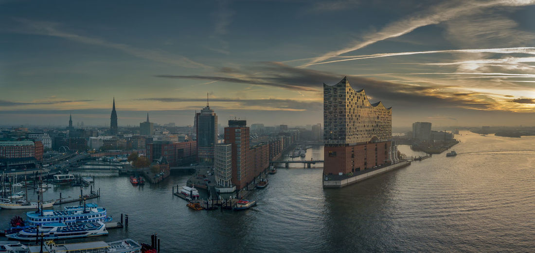 The elbphilharmonie at sunrise in the harbour of hambrug