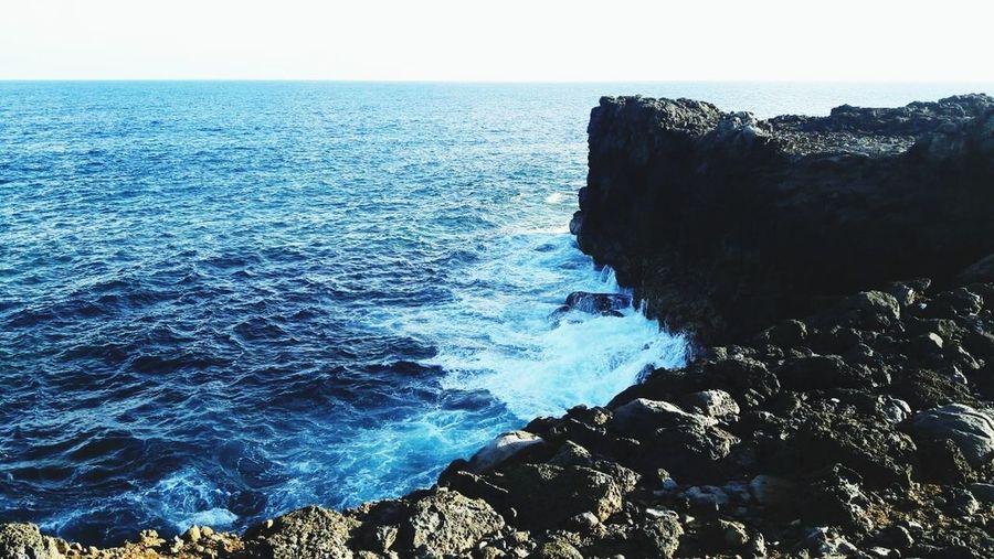 sea splashing on rocks Very Calm
