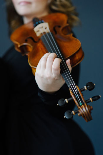 Violin Music Artist Arts Culture And Entertainment Bow - Musical Equipment Focus On Foreground Hand Holding Human Hand Indoors  Music Musical Equipment Musical Instrument Musical Instrument String Musician One Person Performance Playing Skill  String String Instrument Violin Violinist