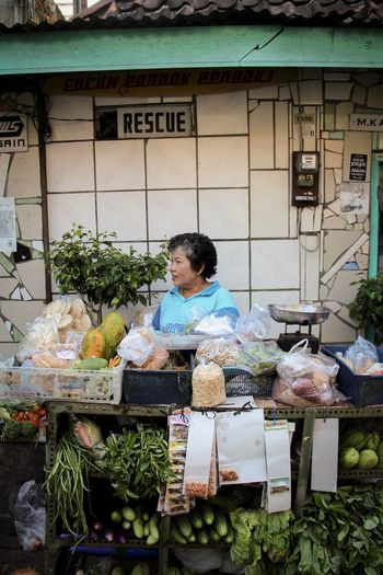 Woman selling vegetables in market