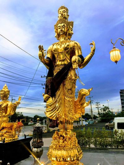 Statue Of Deity Golden Art And Craft Representation Sculpture Statue Human Representation Sky Creativity Cloud - Sky Gold Colored Outdoors Day Religion No People Architecture Craft Nature Built Structure Male Likeness Belief