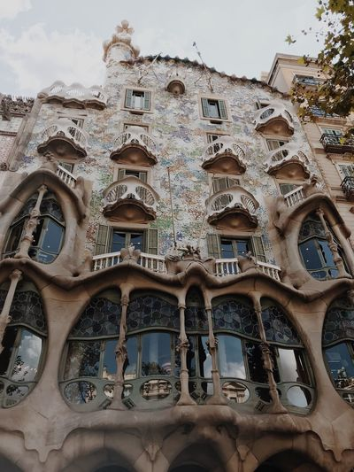 Casa Batllo Antoni Gaudí Barcelona Built Structure Building Exterior Architecture Low Angle View Building Day Window Travel Destinations No People Tourism Religion Art And Craft Sky Place Of Worship Creativity Belief Pattern History The Past Travel