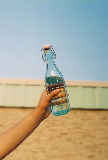 Cropped Hand Holding Water Bottle