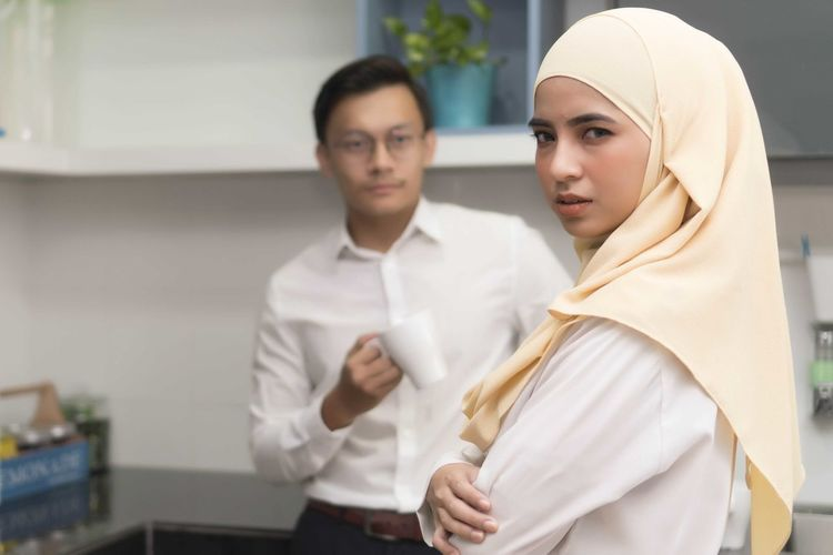 Young Malay Muslim wearing Hijab at the Pantry, Looking at the camera Two People Indoors  Adult Clothing Waist Up Young Adult Traditional Clothing Young Women Women People Men Standing Looking At Camera Real People Togetherness Portrait Hijab Front View Occupation Males  Lab Coat Menswear