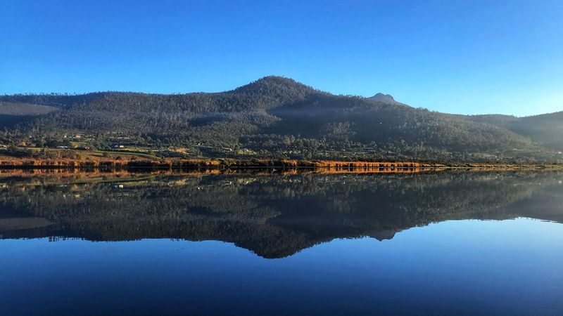 Derwent River, Tasmania Tasmania Water Reflection Sky Mountain Tranquility Clear Sky Lake Blue Beauty In Nature Tranquil Scene Scenics - Nature Nature Waterfront Symmetry Outdoors