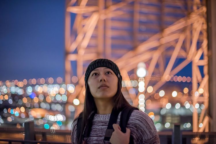 Portrait Of Beautiful Woman In City Against Sky At Night
