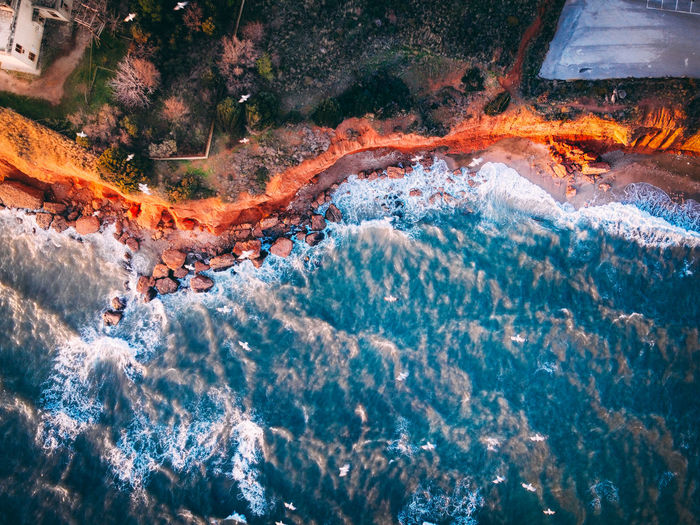 High angle view of water flowing over sea