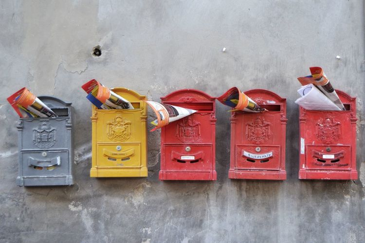 Old mailboxes mounted on wall