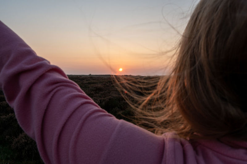 Close-up portrait of a woman at sunset