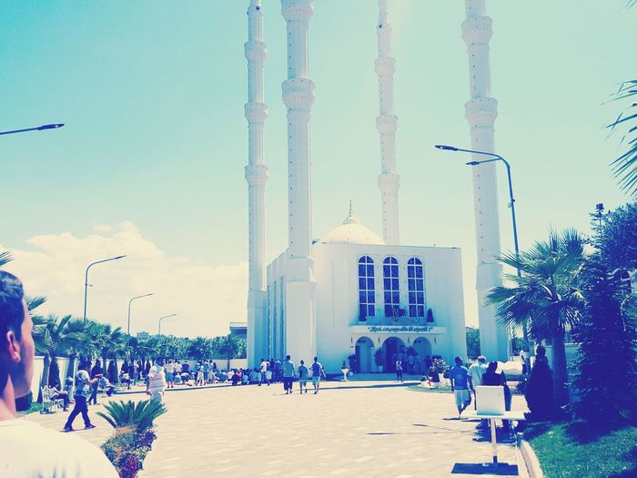 Albanian Tourist Person Famous Place Outdoors Monument Day Everyday Joy First Eyeem Photo Large Group Of People Street Light Lighting Equipment Architecture Built Structure Tall - High Tourism Sky Tower Travel Destinations Tourist Building Exterior Person City City Life Famous Place