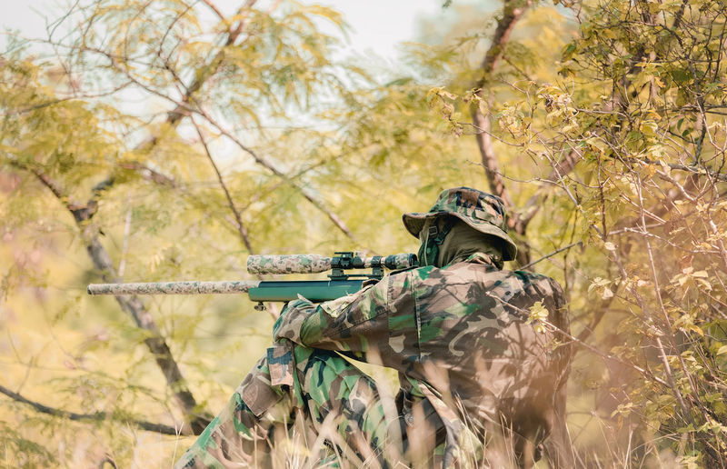 Fully Equipped Soldiers Wearing Camouflage Uniform Attacking Enemy, Airsoft military game player in camouflage uniform Military Tree Armed Forces Gun Weapon Government Plant Army Rifle Nature Army Soldier Day Camouflage Clothing Land Security Aiming Protection Military Uniform Uniform Fighting Outdoors Special Forces Aggression