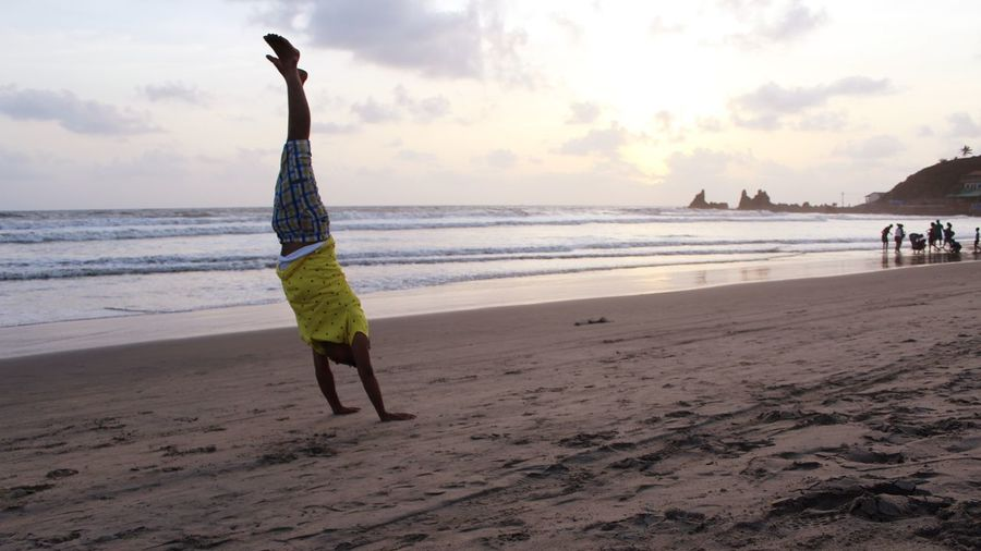 Being the Beach acrobat Adult Adults Only Beach Beauty In Nature Day Full Length Horizon Over Water Leisure Activity Lifestyles Men Nature One Person Outdoors Real People Sand Scenics Sea Shore Sky Standing Sunset Vacations Walking Water Women